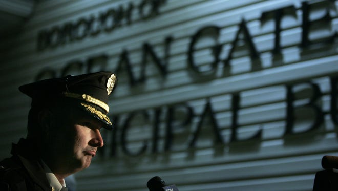 Ocean Gate Police Chief Reece Fisher is pictured in a 2010 file photo at a candlelight service for a slain officer.