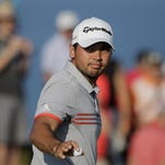 Jason Day, of Australia, reacts after making an eagle putt on the 11th hole during the third round of the PGA Championship golf tournament Saturday, Aug. 15, 2015, at Whistling Straits in Haven, Wis.