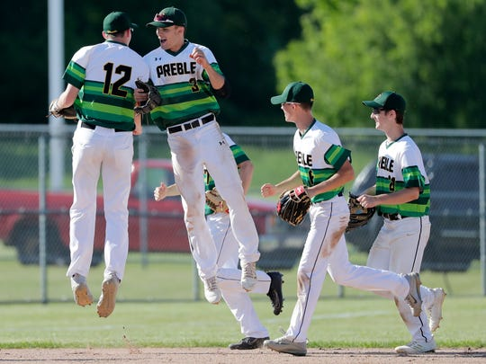 Green Bay Preble's Colin Dougherty (3) and Josh Nicklaus (12) celebrate a defensive play against Antigo in a WIAA baseball sectional final at Bay Port high school on Tuesday, June 5, 2018 in Suamico, Wis. Adam Wesley/USA TODAY NETWORK-Wisconsin