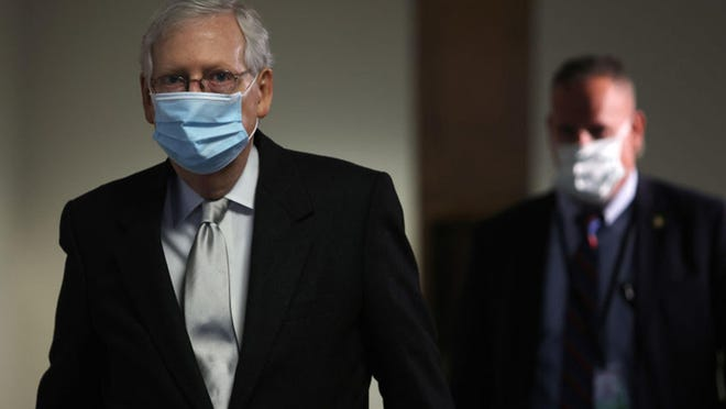 U.S. Senate Majority Leader Sen. Mitch McConnell (R-KY) leaves after a Senate Republican policy luncheon at the Hart Senate Office Building Nov. 18, 2020 on Capitol Hill in Washington, DC.