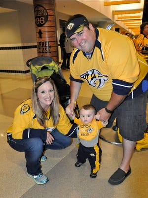 Murfreesboro Police officer Matthew Stern, his wife Stephanie and their son Hunter, 1, at a Nashville Predators fame. Stern was injured in a motorcycle crash while on duty last week and is making a slow but steady recovery at Vanderbilt.