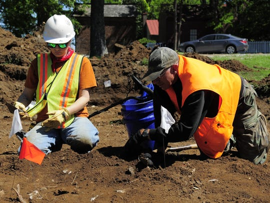 Archaeologists  Amanda Garvin, left, and Matt Spice carefully go through the uncovered earth at the Carter Hill Battlefield Park in Franklin Tuesday, May 2, 2016.