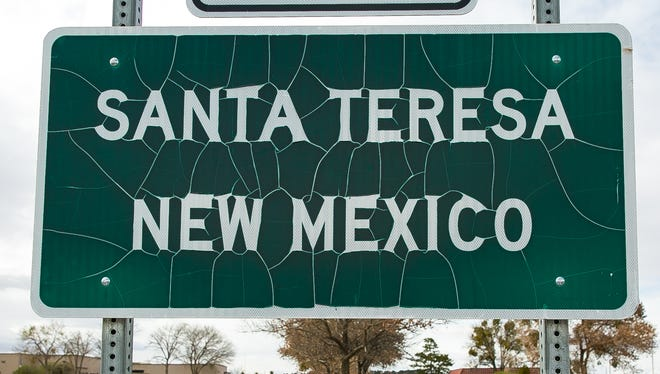 A Santa Teresa sign posted at the intersection of Country Club Road and McNutt Road.