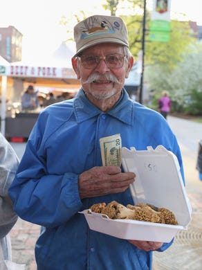George Hukill of West Des Moines, holds a box of morel