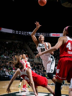 Michigan State's Branndais Agee (10) puts up a shot as she collides with Wisconsin's Nicole Bauman in the lane Sunday, Jan. 3, 2016, in East Lansing, Mich. Michigan State won 77-67.