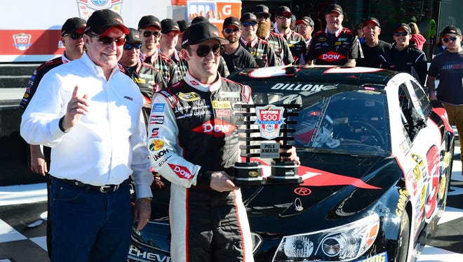 Austin Dillon and grandfather/team owner Richard Childress, left, celebrate Dillon winning the pole for the 2014 Daytona 500.