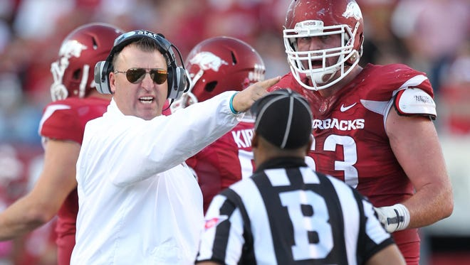 Arkansas head coach Bret Bielema will look to direct the Razorbacks to the program's fifth all-time win against the country's top-ranked team on Saturday at Mississippi State.