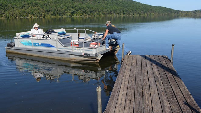 George Watts pushes off from the dock at Paris Reservoir with Dennis Willman as they head out for an afternoon of fishing Thursday, Sept. 24, 2020. The River Valley weather forecast this week calls for fall-like temps, with temperate days and cool nights.