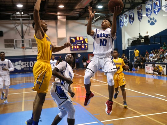 Godby's Tavaris King lays the ball up against Rickards'