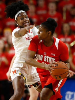 Maryland guard Kaila Charles, left, pressures Ohio State guard Janai Crooms in the second half of an NCAA college basketball game, Saturday, Jan. 5, 2019, in College Park, Md. (AP Photo/Patrick Semansky)