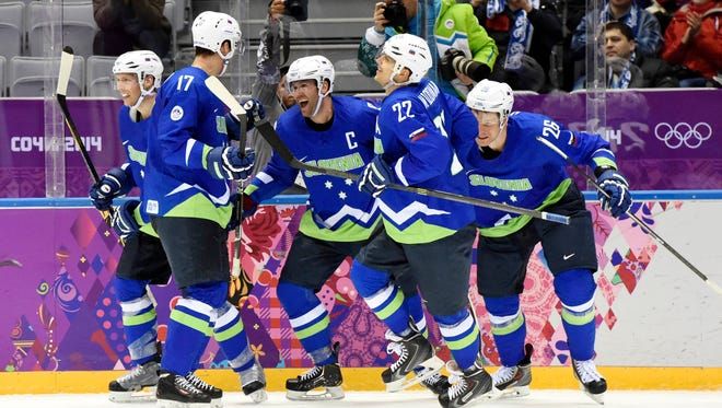 Slovenia forward Tomz Razingar celebrates with teammates after scoring a goal against Slovakia.
