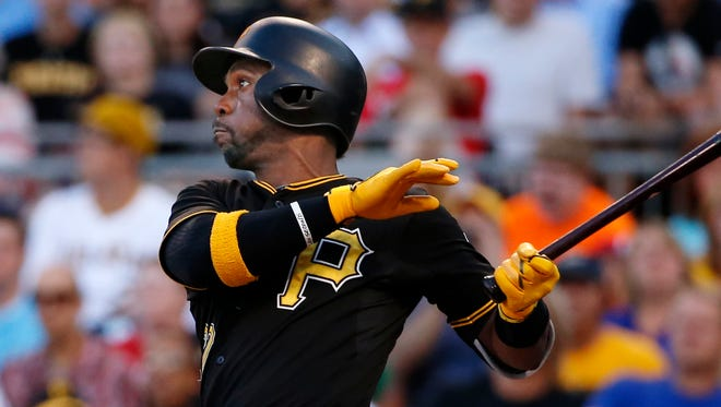 Pirates' Andrew McCutchen hits a solo home run off Cubs starting pitcher Dan Haren.