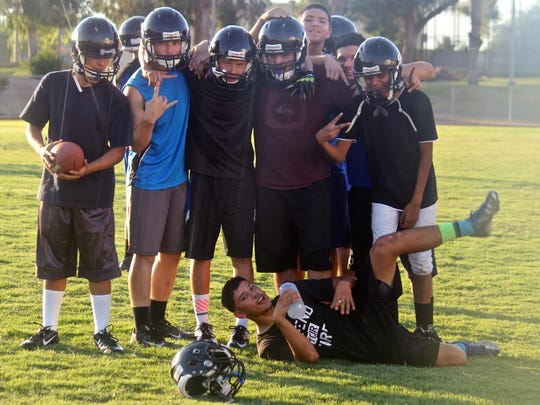 Cathedral City High School students pose for a photograph during the Lions' practice session on Aug. 14, 2015.