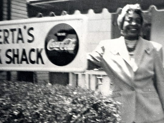 In this undated photo, entrepreneur Alberta Ellis stands outside her Benton Avenue Snack Shack business. Ellis also owned a hotel and a farm west of Springfield, which catered to African American Route 66 travelers.
