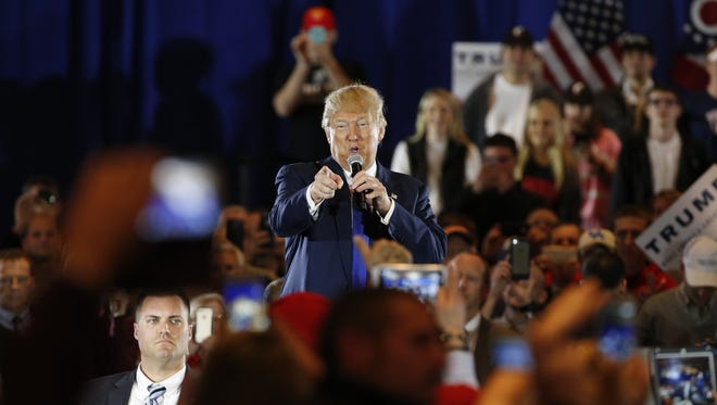 Donald Trump points to the crowd during his campaign stop in West Chester Sunday afternoon.