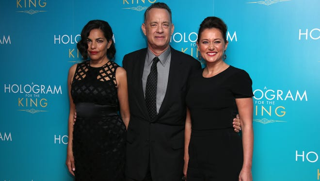 Sarita Choudhury, left, Tom Hanks and Sidse Babett Knudsen pose for photographers upon arrival at the premiere of the film 'A Hologram For The King' in London on April 25, 2016.