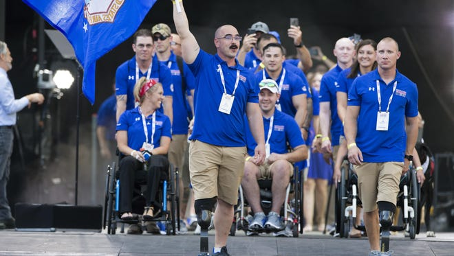 Team Air Force enters opening ceremonies for the 2017 Department of Defense Warrior Games at Soldier Field in Chicago, July 1, 2017. The DOD Warrior Games are an annual event allowing wounded, ill and injured service members and veterans to compete in Paralympic-style sports.