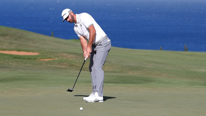 Dustin Johnson putts on the fourth hole during the third round of the Sentry Tournament of Champions at Kapalua Resort in Maui, Hawaii.