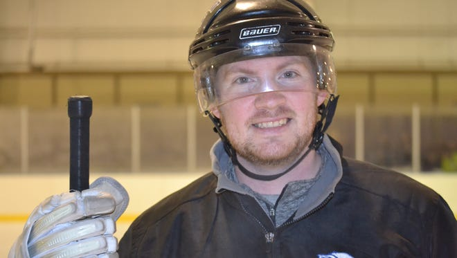 Josh McAfee has been playing hockey since age ten, and now he coaches the Ice Wolves' Squirt team.