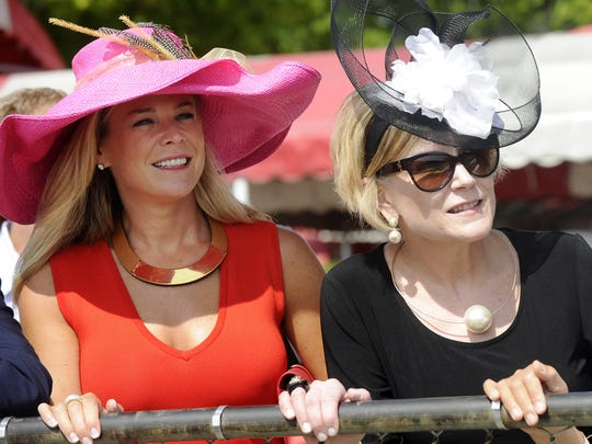 Monica Oberting of Menands, N.Y., left, Jill Taylor of Jacksonville, Fla. ,Center, and Mei Zhang ,right, of New York, N.Y, watching racing action prior to the Travers Stakes horse race at Saratoga Race Course in Saratoga Springs last August.