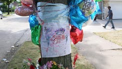 Milwaukee officials have removed a curbside memorial