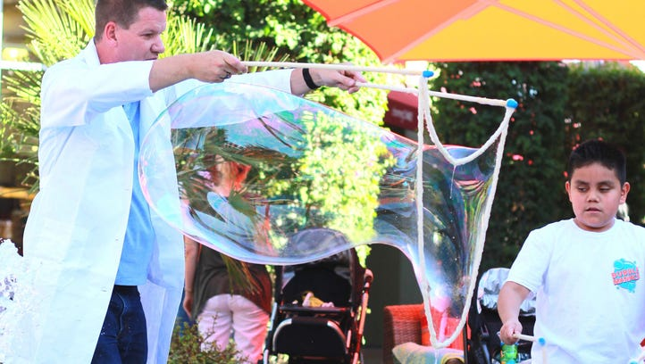 A bubble master demonstrates how to make a gigantic
