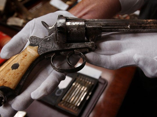 FILE – This July 10, 2003 file photo shows an 1800s revolver that entrepreneur, gambler and lawman Wyatt Earp kept in the Oriental Saloon in Tombstone in the Arizona Territory, displayed at the Harrisburg, Pa., Mayor Stephen Reed's office in Harrisburg. Jury selection is set to begin Monday, Jan. 23, 2017, in the criminal case against Reed, charged with receiving stolen property after spending millions in public funds to buy artifacts for a Wild West museum that was never built. His lawyer says Reed didn't steal anything and was in lawful possession of the items. (AP Photo/Carolyn Kaster, File)