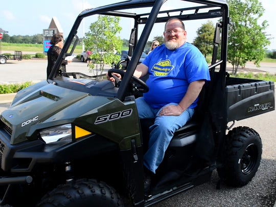Earl Hunt sits in his new Polaris Ranger 500 after winning it in a blood drive hosted by Lifeline Blood Services in Jackson.