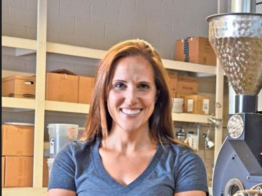 Holly Migliaccio, co-owner of Rook Coffee, offers a