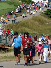 Fans walk near the 10th hole at the PGA Championship