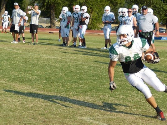 Kody Sindorf runs the ball during practice Monday at Shasta College.