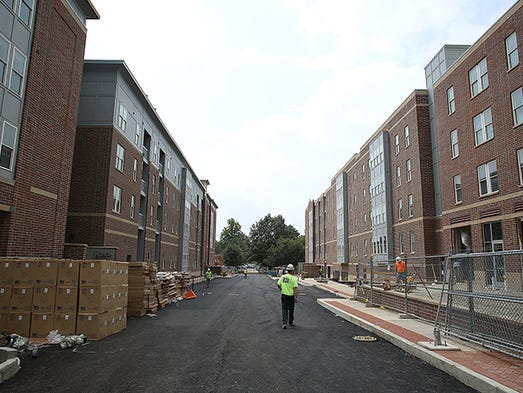 Dill Street runs between the two buildings. With less than a week to go before tenants are to move in, the Village Promenade workers are rushing to finish the project.
