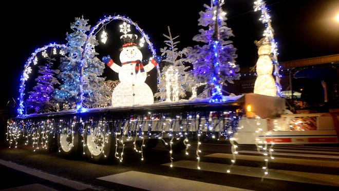 A winter wonderland display is towed during the Holiday Parade in Sublimity, Ore., on Saturday, Dec. 6, 2014.