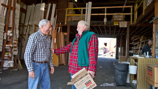 Tim Shaheen (left), CEO and co-owner of Builders' General Supply Co. in Little Silver, talks with customer Frank Crocitto, a contractor from Monroe.