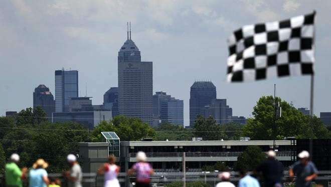 Spectators look eastward toward the Indianapolis skyline during the Indy Legends Pro-Am Charity Race, Saturday, June 13, 2015 at Indianapolis Motor Speedway.