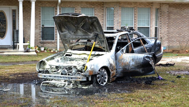 """This Jan. 16, 2012 photo shows the burned remains of Barbara Hicks Collins' car in front of her mother's home in Bogalusa, La. The Louisiana Fire Marshal's Office is investigating the incident, which happened in the early morning hours of Martin Luther King Day, as an """"intentionally set"""" fire. Her father, Robert Hicks, was a long time civil rights activist and the family has remained active in civil rights issues.  For Hicks Collins, the failure to count the 2012 attack as a hate crime is a painful reminder of the continuing struggle for racial progress. """"The more things change,"""" she said, """"the more they remain the same."""""""