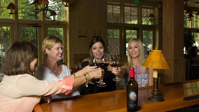 Christine Williams, Mollye Vigodsky, Katie Gross and Cait Gross toast to making it halfway through the week.