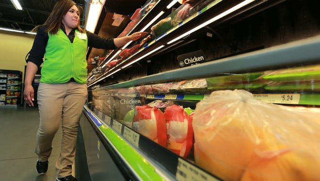 A manager checked the produce section at a Walmart Neighborhood Market in Northeast El Paso earlier this year.