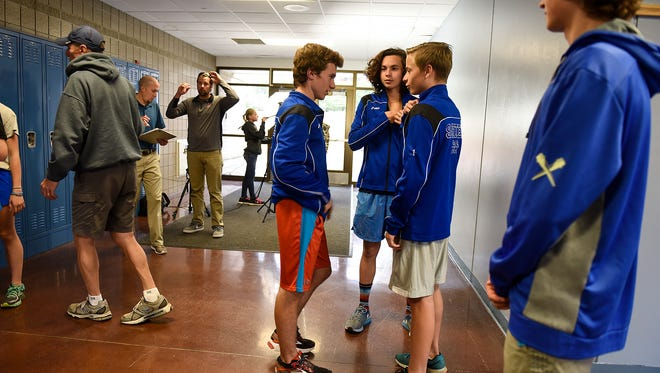 Sartell High School cross country team members gather after school Wednesday, Nov. 2, in Sartell. Sartell will compete as a team during Saturday's Class 2A boys competition in Northfield.