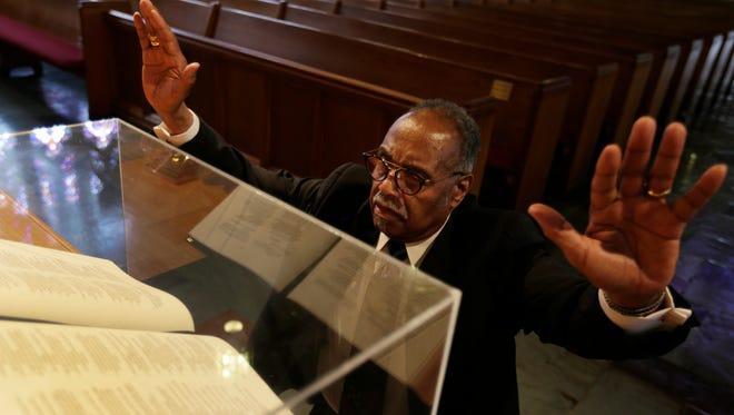 Dr. Charles G. Adams, pastor of Hartford Memorial Church in Detroit, prays on Tuesday, June 27, 2017.