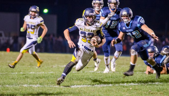 Algonac High School running back Jack Jewell runs the football in for a touchdown during their game against Richmond High School, Oct. 13.