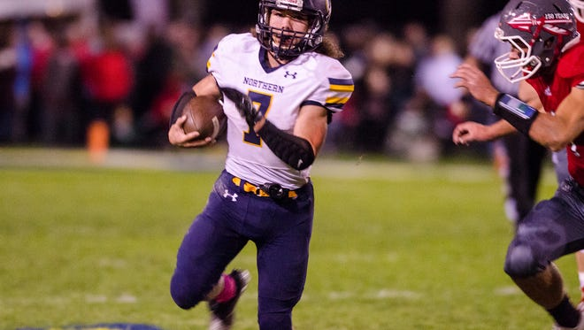 Port Huron Northern's Theo Ellis runs the ball during the Crosstown Showdown football game against Port Huron High School Oct. 20.