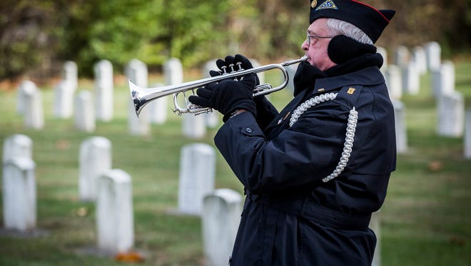 A member of the Delaware County Honor Guard plays Taps during the Beech Grove Cemetery 2017 Veteran's Day Ceremony.