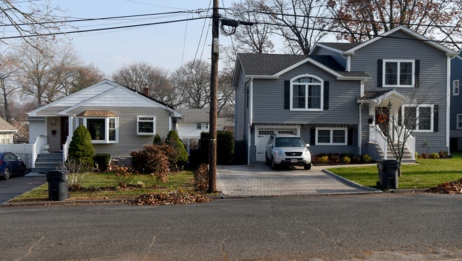 Homes on Greenwich Street in Bergenfield. The owner of the house on the right is one of dozens of taxpayers who was not properly assessed for home improvements.