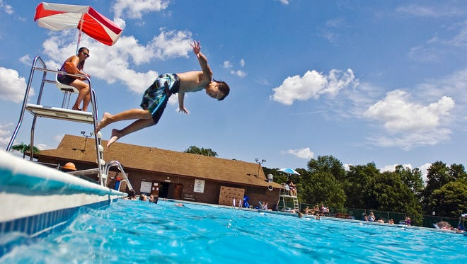 In this file photo from July 2011, Matt Staley, 10, of Bonneauville, dives into the Littlestown swimming pool Friday while swimming with friends.