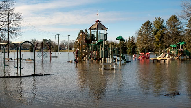 The playground is covered with flood water at Howe Memorial park on Thursday, Feb. 22, 2018, in Eaton Rapids.