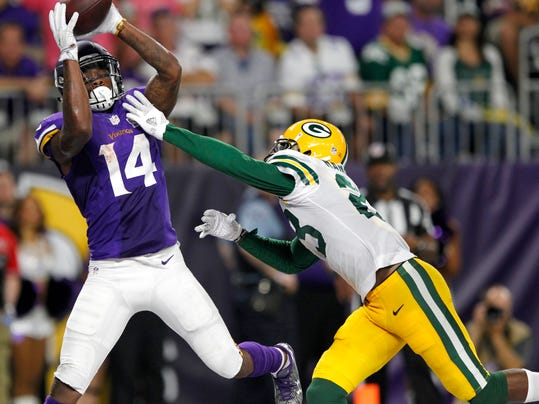 FILE - In this Sept. 18, 2016, file photo, Minnesota Vikings wide receiver Stefon Diggs (14) catches a 25-yard touchdown pass over Green Bay Packers cornerback Damarious Randall, right, during the second half of an NFL football game in Minneapolis.  The Detroit Lions hosts the Minnesota Vikings in a matchup of first-place teams in the NFC North on Thanksgiving Day. Detroit cornerback Darius Slay hopes to help his defense limit receiver Stefon Diggs after he had a career-high 13 receptions in the previous matchup. (AP Photo/Andy Clayton-King, File)