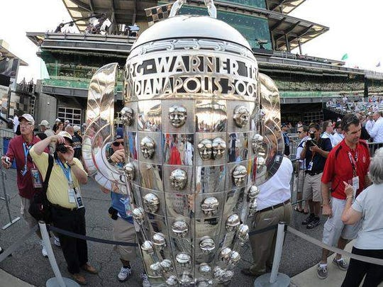 Commissioned in 1935 by the Borg-Warner Automotive Company, the trophy features the likeness of 72 Indianapolis 500 winners. The last to have his image placed on the original trophy was Bobby Rahal in 1986. A new base was added in 1987, and it was filled to capacity following Gil de Ferran's victory in 2003. A third base was added in 2004, that will not be filled to capacity until 2034.