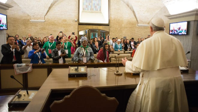 A photo provided by the Vatican newspaper L'Osservatore Romano shows  Pope Francis meeting with participants of the Global Meeting of Popular Movements  at the Vatican.