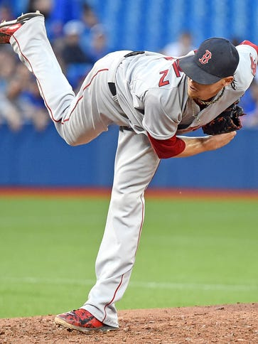 Boston Red Sox pitcher Clay Buchholz (11) delivers